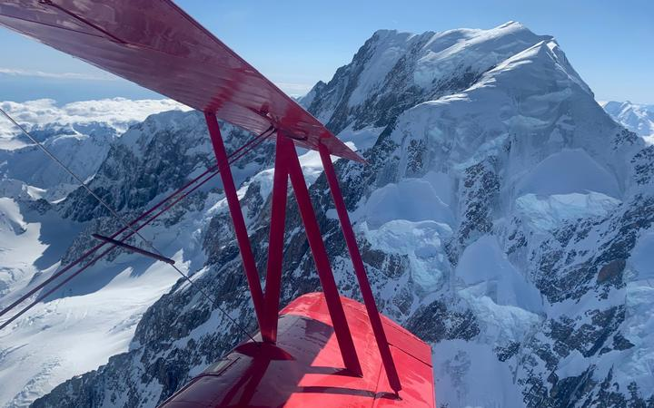 Aviation Adventures owner Chris Rudge flew a Grumman Ag-Cat aircraft over Aoraki/Mount Cook to mark a century since the maiden voyage.