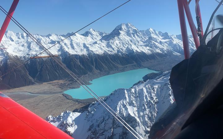 Aviation Adventures owner Chris Rudge says he was over Aoraki / Mt Cook at the exact same time as the first flight 100 years ago to the day.