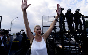 Belarusian musician and political activist Maria Kolesnikova is seen in front of the security forces standing guard to block protestors from reaching the Presidential Palace as people continue to protest over the presidential election in the capital Minsk, Belarus on August 30, 2020.