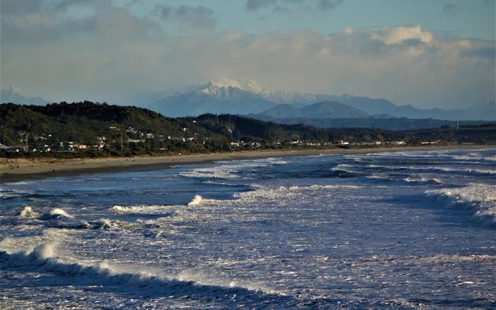 Southern Alps are seen behind Greymouth.