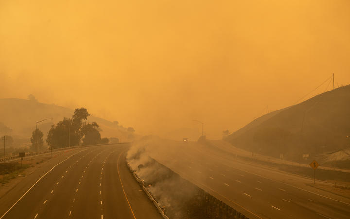 A firetruck drives along a closed Interstate 80 as flames from the LNU Lightning Complex fire continue to spread in Fairfield, California on 19 August, 2020.