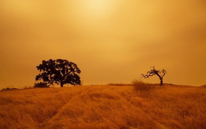 An orange sky filled with wildfire smoke hangs above hiking trails at the Limeridge Open Space in Concord, California, on 9 September, 2020.