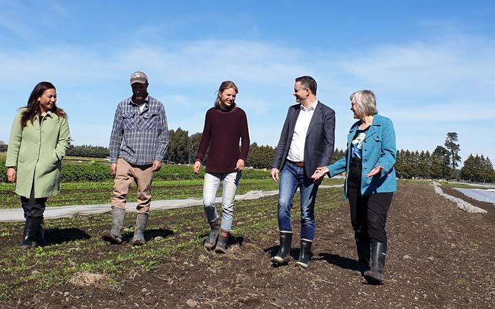 Green Party co-leaders Marama Davidson and James Shaw along with environment spokesperson Eugenie Sage being shown around by Logan Kerr and Dominique Schacherer on an organic farm in Leeston on 12 September, 2020.