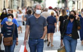People wearing face masks, to curb the spread of Covid-19 in Nantes, western France.