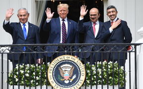 Israeli Prime Minister Benjamin Netanyahu, US President Donald Trump, Bahrain Foreign Minister Abdullatif al-Zayani, and UAE Foreign Minister Abdullah bin Zayed Al-Nahyan wave from the Balcony at the White House in Washington on 15 September, 2020.