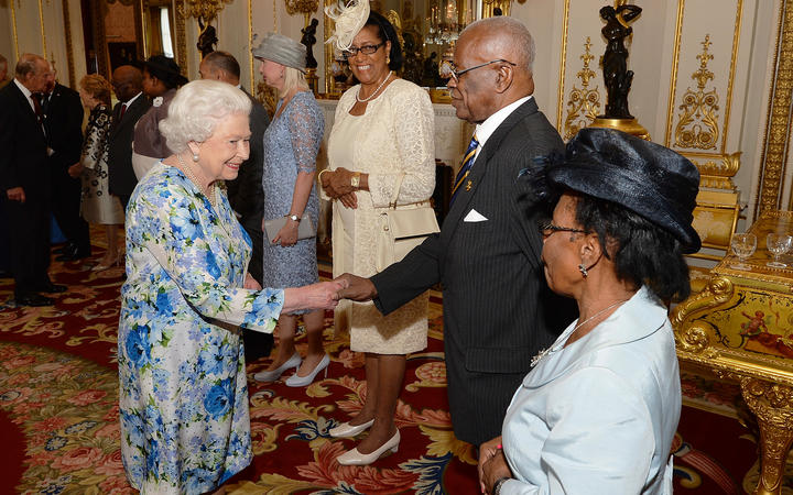The Queen shakes hands with the Governor-General of Barbados, Elliott Belgrave, during a reception ahead of the Governor General's lunch in honour of the Queen's 90th birthday at Buckingham Palace in London, June 10, 2016.