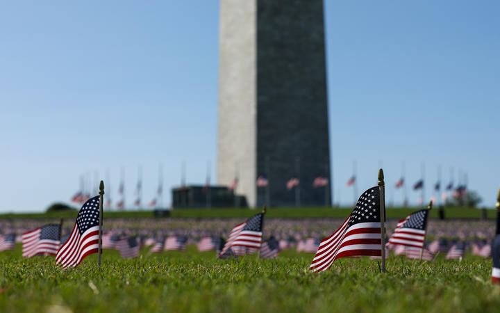 American flags placed on the National Mall by the Covid Memorial Project to represent the 200,000 Americans that have lost their lives due to the coronavirus.
