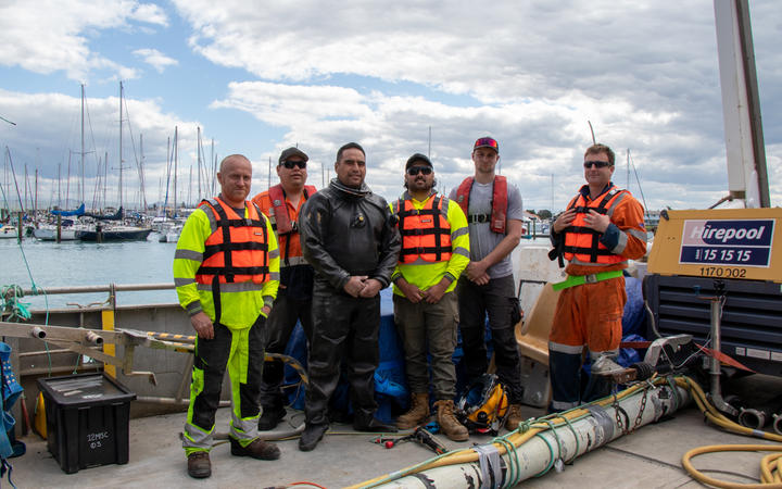 Workers get ready to fix a sewage pipe in Nelson which is leaking into the ocean.