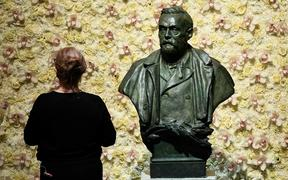 (FILES) In this file photo taken on December 10, 2019 a visitor stands in front of a bust of the Nobel Prize founder, Alfred Nobel prior the Nobel awards ceremony  at the Concert Hall in Stockholm, Sweden.
