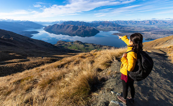 Young person hiking on Roys peak track, Wanaka, South Island, New Zealand