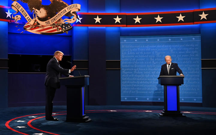 US President Donald Trump (L) and Democratic Presidential candidate and former US Vice President Joe Biden exchange arguments during the first presidential debate at the Case Western Reserve University and Cleveland Clinic in Cleveland, Ohio on September 29, 2020. (Photo by Jim WATSON / AFP)