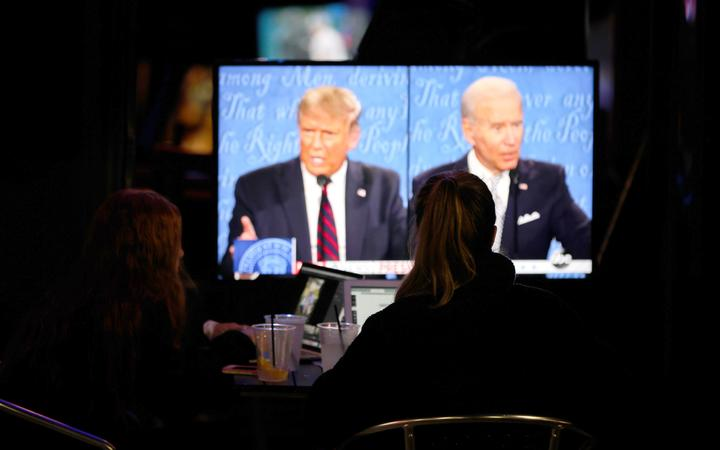 People watch the first presidential debate between US President Donald Trump and former US Vice President Joe Biden.