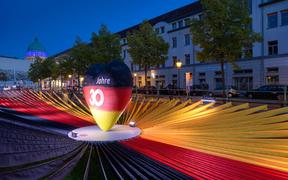 "A black-red-golden heart is in the centre of black, red and yellow fabric panels in the exhibition ""Path to Unity"" at the Unity EXPO. Potsdam, as the capital of Brandenburg, is this year's host of the central celebrations of German Unity Day."