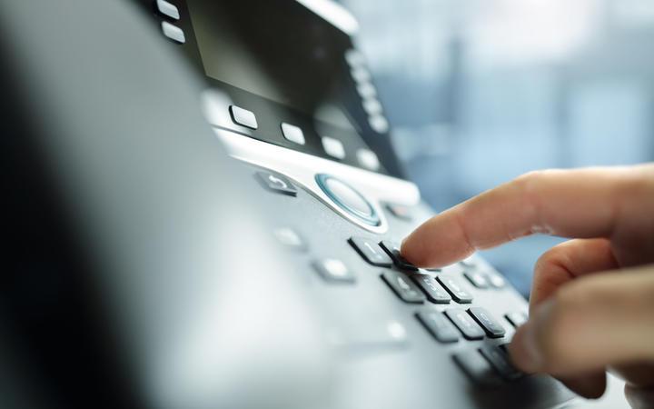 Dialing a telephone keypad.