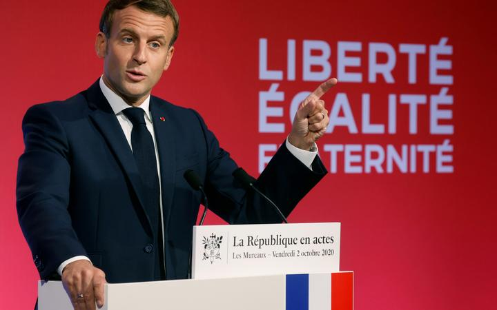 French President Emmanuel Macron delivering a speech on his strategy to fight separatism, near Paris.