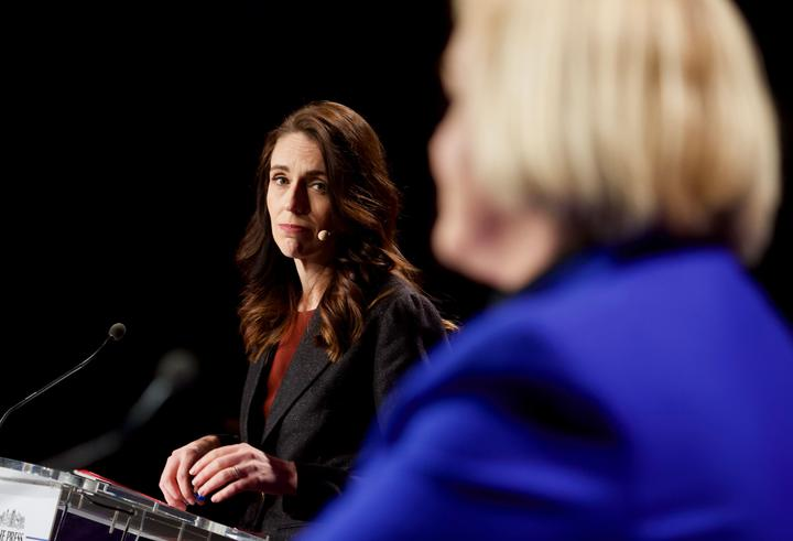 Labour leader Jacinda Ardern looks on as National leader Judith Collins speaks at The Press debate in Christchurch.  06/10/20
