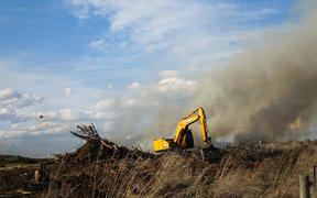 A digger takes part in the fight against the Lake Ohau fire
