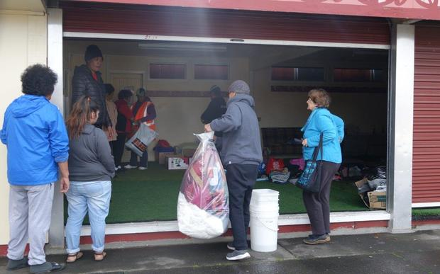 People drop off donations at Te Puea Marae.