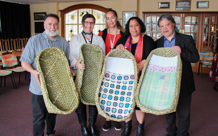 From left, Dr Ruakere Hond, Rachael Peek, Taranaki DHB associate director of Midwifery, Grace Maha, Taranaki DHB midwife and SUDI prevention coordinator, and Puhi and Philip Nuku, local weavers.