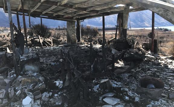 A fire-ravished home in Lake Ōhau Village.