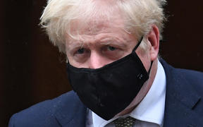 Britain's Prime Minister Boris Johnson wearing a face mask  leaves 10 Downing Street ion October 12, 2020 headed for the House of Commons, where he is set to announce a new Covid-19 alert system.