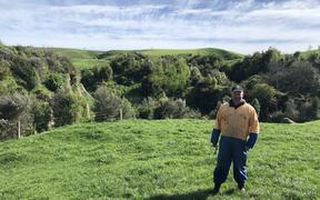 Farmer Chris Lewis near a grove of trees planted six years ago