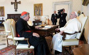 Pope Francis talks with Cardinal George Pell