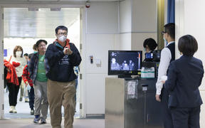 Taiwan's Center for Disease Control personnel using thermal scanners to screen passengers arriving on a flight earlier this year.