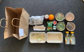Meal packaging in managed isolation.