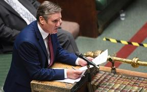 "A handout photograph released by the UK Parliament shows Britain's main opposition Labour Party leader Keir Starmer. Prime Minister Boris Johnson on Wednesday said a new UK-wide lockdown would be a ""disaster."