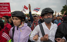 Pro-democracy protesters march toward  Government House during an anti government demonstration on October 14, 2020 in Bangkok, Thailand.