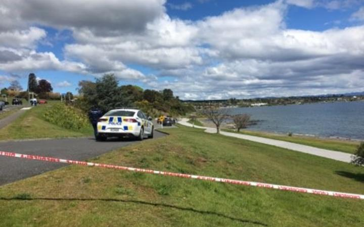 Police at the scene in Lake Taupō where two bodies were discovered.
