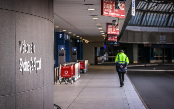 (File photo) A security guard outside the departures area of the Sydney International Airport in Sydney, 29 September 2020.