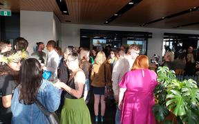 Guests arriving at the Green Party's election night party at the Grid X building in Auckland.