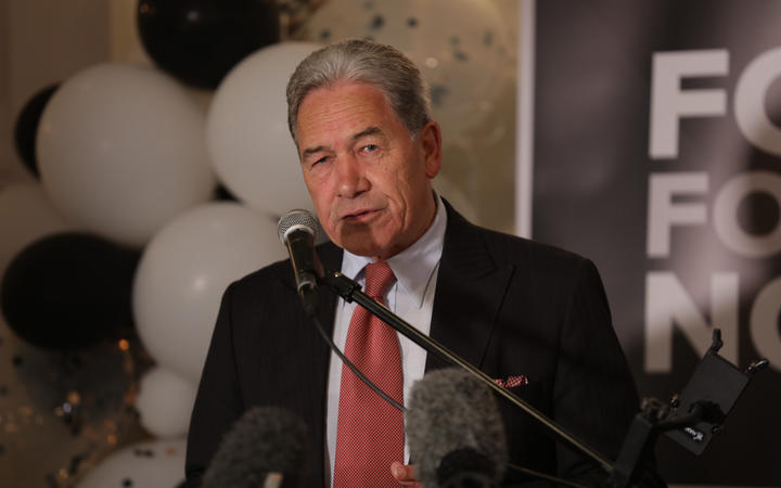 New Zealand First leader Winston Peters speaking to supporters at the party's headquarters at Russell.