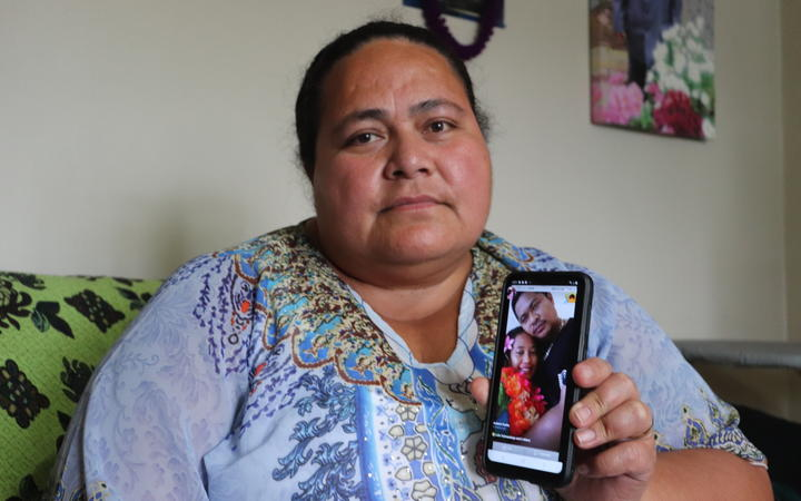 Lofa Tuimaualuga holds a photo of her nephew Tino Tagiilima, with his wife. Tagiilima died in a tragic highway crash in the North Island yesterday.