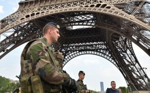 France is already under a state of emergency. Here, soldiers patrol the Eiffel Tower, in Paris.