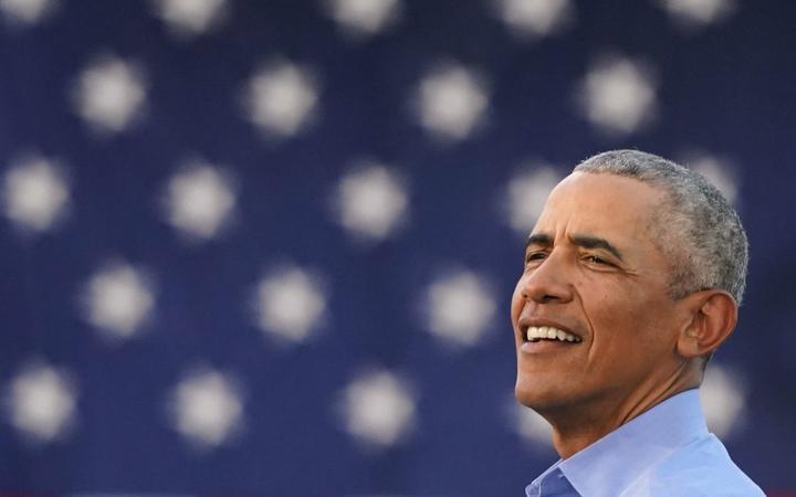 Former US President Barack Obama addresses Biden-Harris supporters during a drive-in rally in Philadelphia, Pennsylvania on October 21, 2020. -