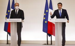 "French Health Minister Olivier Veran (right) and French Prime Minister Jean Castex at a media conference in Paris, announcing the changeover of several departments to ""maximum alert"" and new curfew measures in order to curb the spread of the Covid-19."