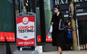A person walks past a Covid-19 Testing Center in the Borough Park section of Brooklyn, one of the five boroughs of New York City on 9 October 2020.