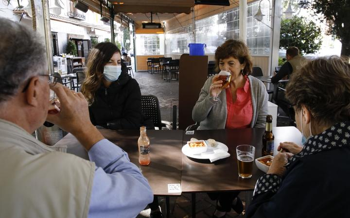 People in a restaurant in Granada on October 23, 2020. COVID-19 infections are increasing in Granada (Spain) and the Government of Andalusia decided to make wearing face masks mandatory