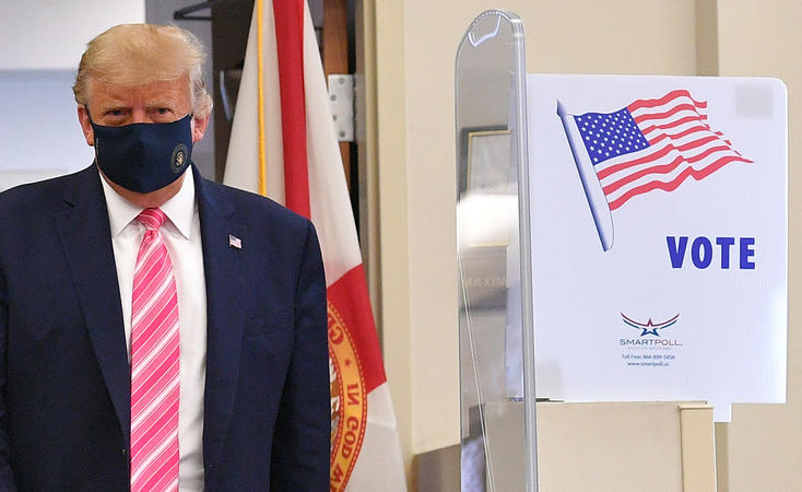 Donald Trump leaves the polling station after casting his ballot at the Palm Beach County Public Library, during early voting for the 3 November election.