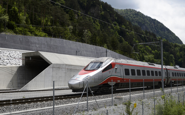 An Italian train makes its way at the north entrance of the new Gotthard Base Tunnel the world's longest train tunnel on the eve of its opening ceremony.