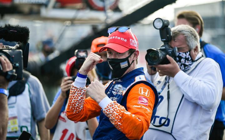 Scott Dixon wearing a mask along with media after his claiming his sixth series crown on 26 October, 2020.