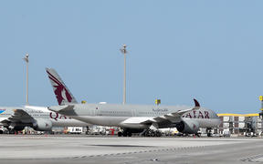A Qatar Airways Airbus A350-941 aircraft is seen on the tarmac at Hamad International Airport in the Qatari capital Doha.