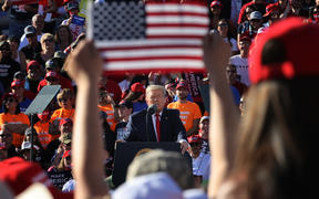 US President Donald Trump addresses thousands of supporters during a campaign rally at Phoenix Goodyear Airport October 28, 2020.