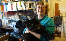 Jane Newman with Thorin, one of the feral toms rescued from the red zone.