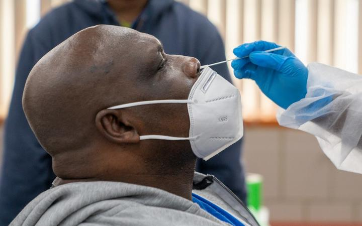 NEW YORK, NY - OCTOBER 30: Michael Stanley an employee for the MTA, is administered a COVID-19 test on October 30, 2020 in New York City.