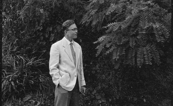 Portrait of Douglas Lilburn taken in the garden of his house at 22 Ascot Terrace, Thorndon, Wellington, 1960s.