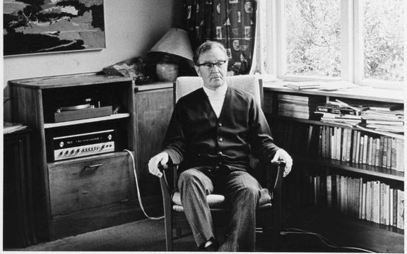 Douglas Lilburn in the sitting room of his home at 22 Ascot Terrace, Thorndon, Wellington, circa 1970.